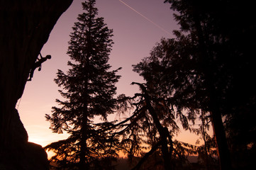 Silhouette of rock climber rock climbing at sunset, Flagstone, Eugene, Oregon, United States