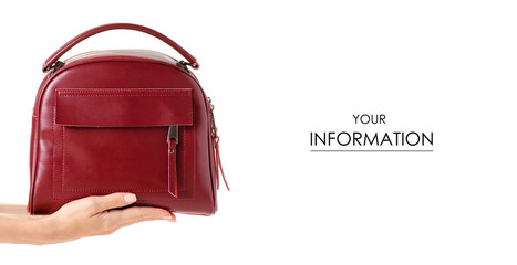 Red leather female bag in hand pattern on white background isolation