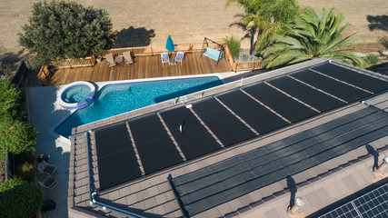 Thermal Solar Panels Installed on the Roof of a Large House