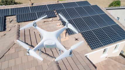 UAV Drone Inspecting Solar Panels On Large House