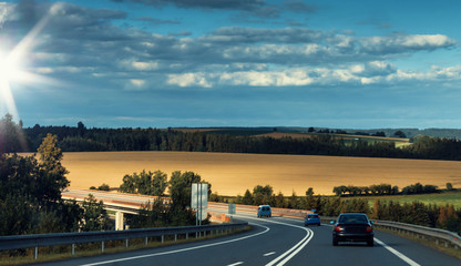 Cars on Highway Photo with Evening Sky