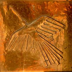 Relief bronze panels of Inca symbols
