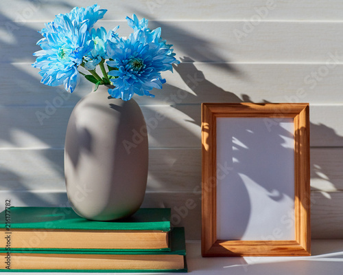 An Empty Wooden Frame Is On A White Wooden Background Nearby Is A