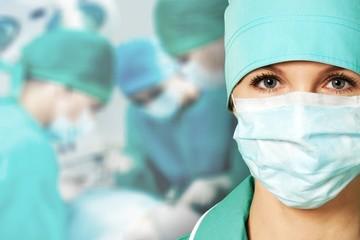 Smiling Nurse / Doctor on hospital background
