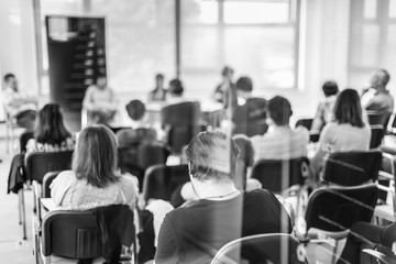 Round table discussion at Business convention and Presentation. Audience at the conference hall. Business and entrepreneurship symposium. Black and white image.
