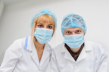 Doctors with masck  in a medical office