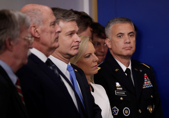 U.S. national security, intelligence and law enforcement officials attend a briefing at White House in Washington