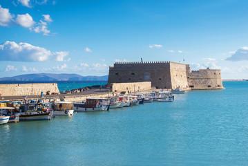 boats in old Venetian Harbour in summer sunny day, Heraklion, Gr