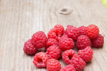 Raspberries on a wooden background. Selective focus.