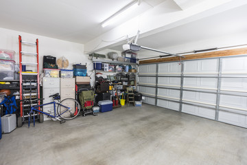 Organized suburban residential garage with shelves, file cabinets, tools and sports equipment.   Wall mural