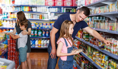Man and daughter choosing meal for home