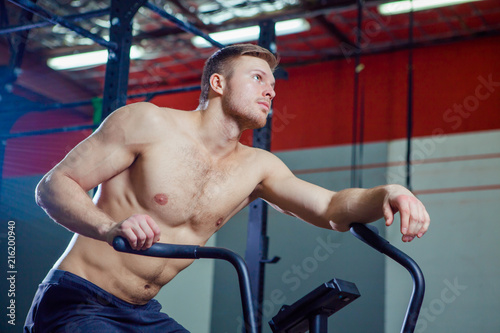 Fit Young Man Using Exercise Bike At The Gym Fitness Male Air For