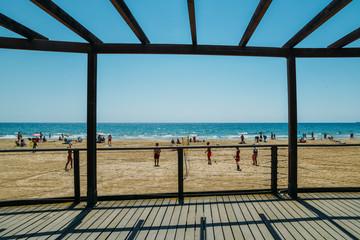 Vacationers in Arrabassada Beach, one of the famous golden sand beaches in the Spanish Costa Daurada