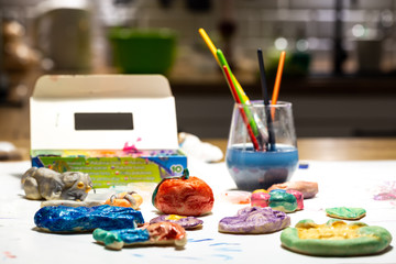 Home fun in painting cakes with salt. Creative fun of children in spare time.