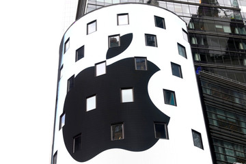 An electronic screen displays the Apple Inc. logo on the exterior of the Nasdaq Market Site following the close of the day's trading session in New York City