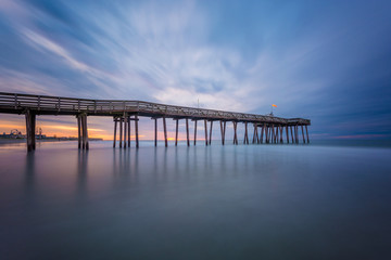 A pier at sunrise in Ocean City, New Jersey.