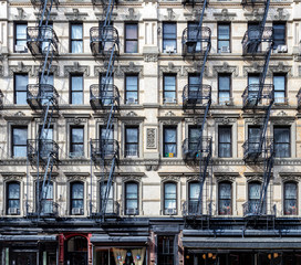 Wall of windows on an old apartment building in the Lower East Side neighborhood of Manhattan, New York City