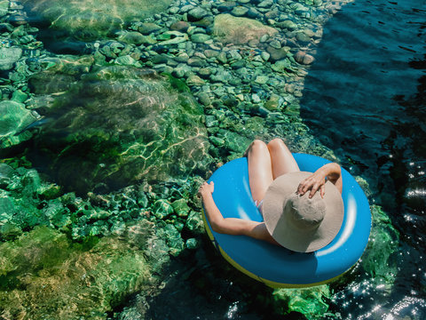 woman with pamela on a float on a mountain river