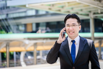 The asian businessman has working on mobile with happy.