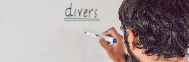 diver writes a marker on the board BANNER, long format