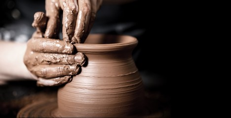 Hands of potter making clay pot Fototapete