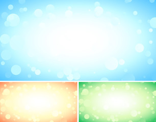 Set of three abstract blue backgrounds with bokeh lights