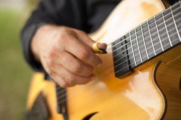 Detail of guitarist playing seven string guitar