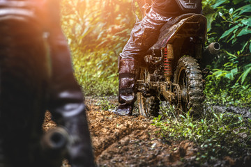 Motocross with mud road.