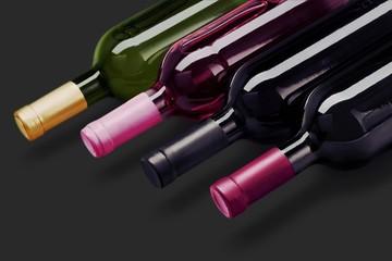 Dark wine bottles in row