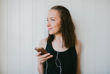 Girl listens to music with headphones