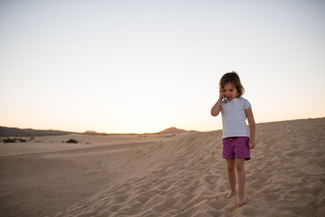 Girl lost in desert and calling