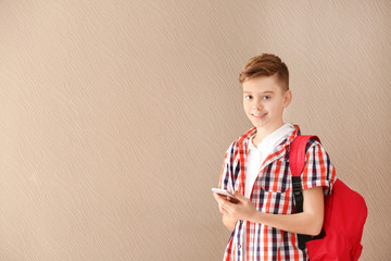 Portrait of teenager with mobile phone on color background