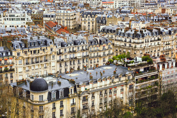 Aerial view of cityscape, old town, historical streets, typical parisian rooftops, traditional facades of old french houses, exterior of buildings. Top of city from Eiffel Tower in Paris, France.