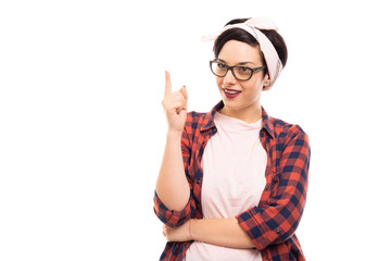 Young pretty pin-up girl wearing glasses making idea gesture.