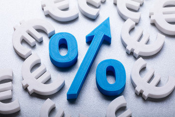 Many Euro Currency Signs Surrounding Blue Percentage Symbol