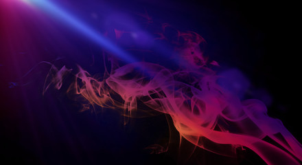 Multi-colored smoke on a dark background, neon light, laser beams