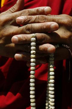 Hand of monk holding  buddhist rosary-mala-nenju