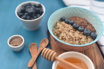 Buckwheat porridge in a bowl with flax seeds and blueberries. oncept healthy food, detox, diet, breakfast