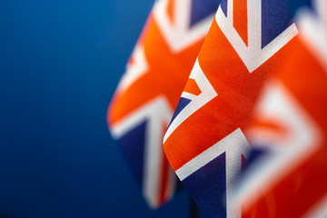 Flags of Great Britain with blue background and space for your project.