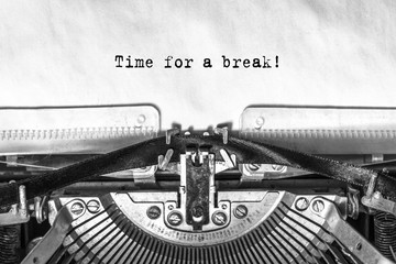 Time for a break, typed text on an old typewriter, close-up, ink on paper