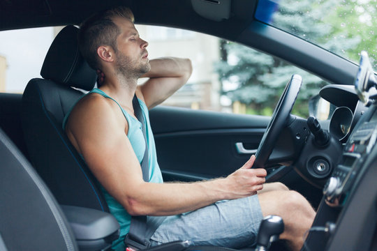 Man with back pain after a long drive in car