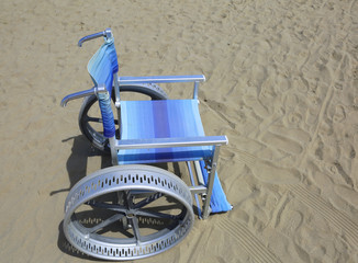 wheelchair with wheels to move easily on the sand of the beach