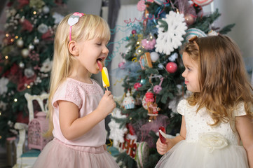 Two cute little girls in a festive New Year's atmosphere