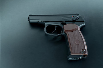Automatic gun pistol on dark background