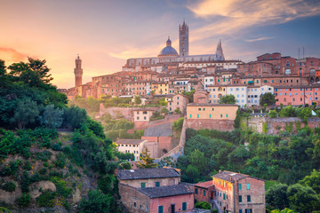 Siena. Cityscape aerial image of medieval city of Siena, Italy during sunrise.