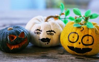 Halloween pumpkin face closeup on wooden table blur background. Concept of Halloween's Day