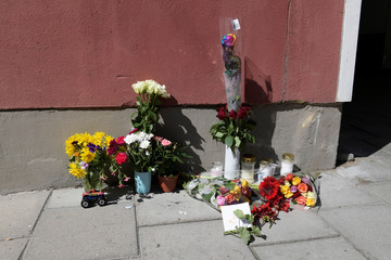 Flowers and condolences are seen outside the place, where a 20 year old man with Down's syndrome, who was carrying a toy gun that was mistaken for a real gun, was shot and killed by the police, in Stockholm