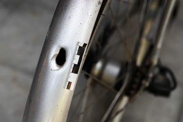 A bullet hole in a bicycle is seen outside the place, where a 20 year old man with Down's syndrome, who was carrying a toy gun that was mistaken for a real gun, was shot and killed by the police, in Stockholm