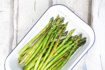 Boiled organic green asparagus in souffle dish