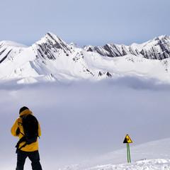 Freerider on snowy off-piste slope in mist